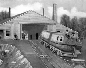 An etching of a boat on rails being pulled up a steep hill, into a large shed. Railroad workers stand near the shed and on top of the boat.